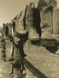 Cowboy Boots on a Fence